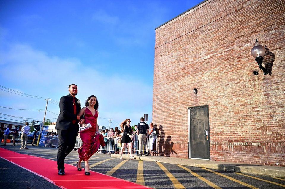Justin Ramos and Kriscia Mendoza walk the red