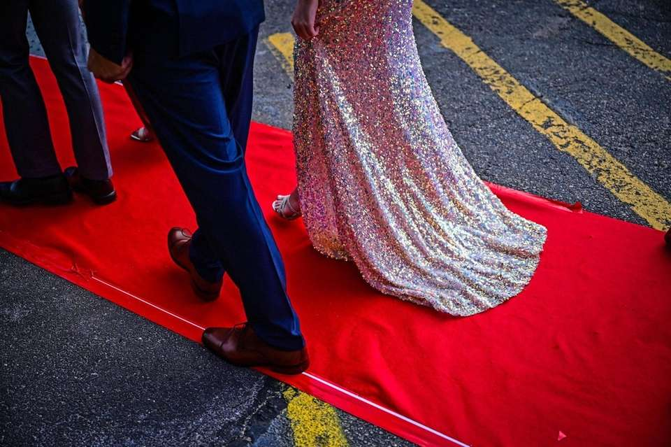 Students walk the red carpet as they attend