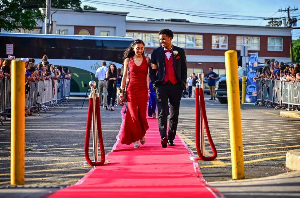 Celena Coutard and Kenny Daniels walk the red