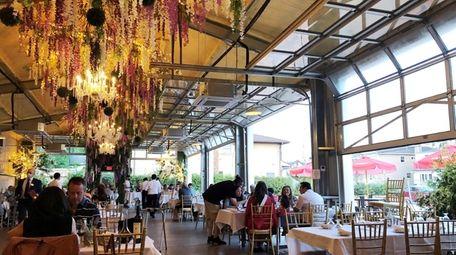The cavernous indoor-outdoor patio at King Umberto in