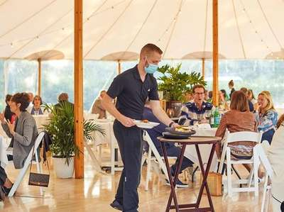Outdoor tent dining at Stone Creek Inn in