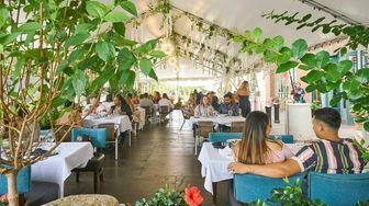 Patrons enjoy outdoor dining at Revel in Garden
