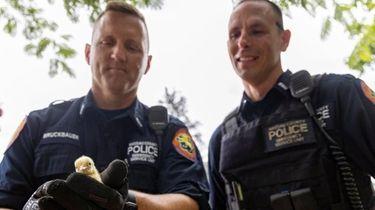Nassau County ESU police officers rescue a baby