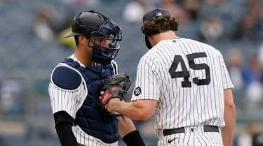 Yankees starting pitcher Gerrit Cole (45) puts his