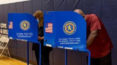 John Conner and Katheryn Chacana cast their ballot