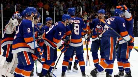 The Islanders celebrate after their 3-2 win against