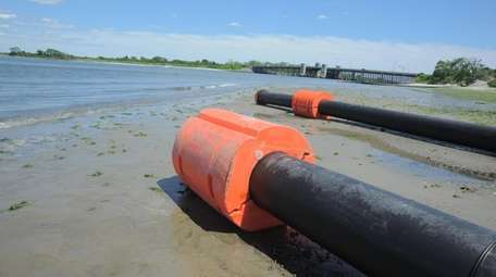 Pipes at the dredging of Sea Dog Creek