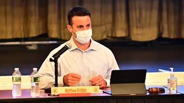 School board president Matthew Gribbin speaks during a
