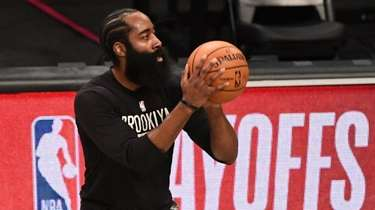 Nets guard James Harden warms up before Game