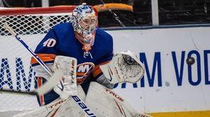 Islanders' goalie Semyon Varlamov makes a stop in