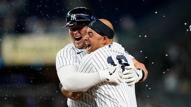 Yankees Luke Voit celebrates with Yankees Rougned Odor