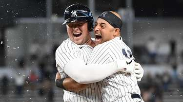 Yankees' Luke Voit celebrates with Rougned Odor after