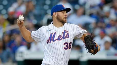 Tylor Megill #38 of the Mets pitches against