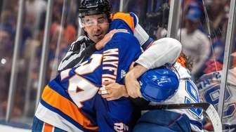 New York Islander's Scott Mayfield fighting with the