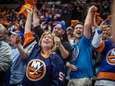Islanders fans cheer during the third period of