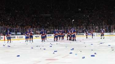 The Islanders wave to the fans as beer