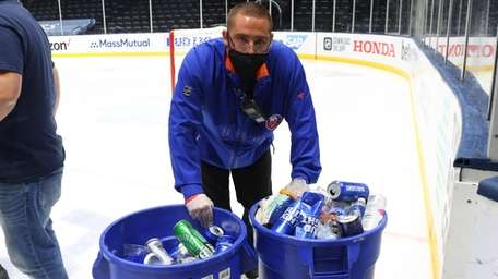 A member of the ice crew collects debris