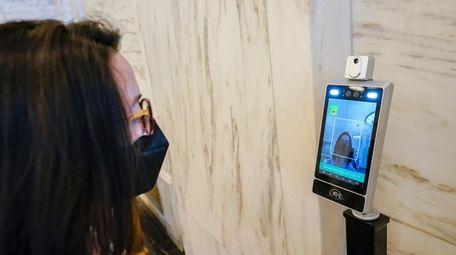 A temperature screening kiosk set up to screen