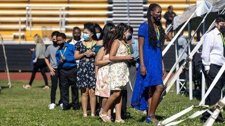 Graduates of Walnut Street Elementary participate in a