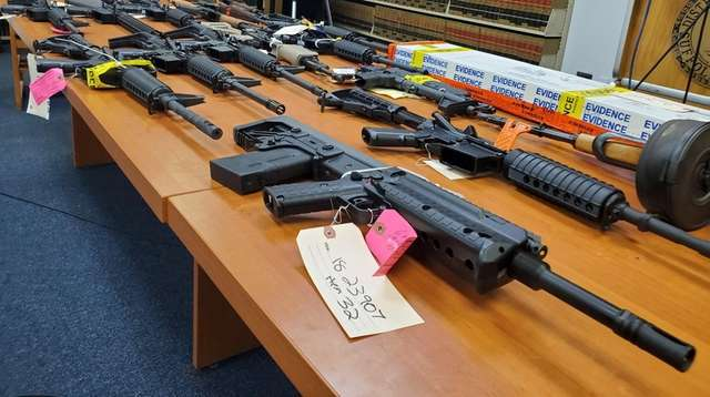 Guns on display during a press conference in