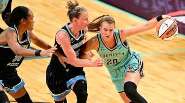Sabrina Ionescu #20 of the Liberty is defended