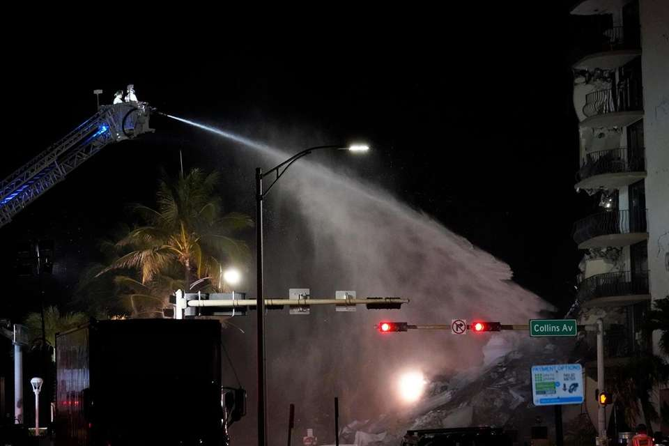 A Miami-Dade Fire Rescue team sprays water onto