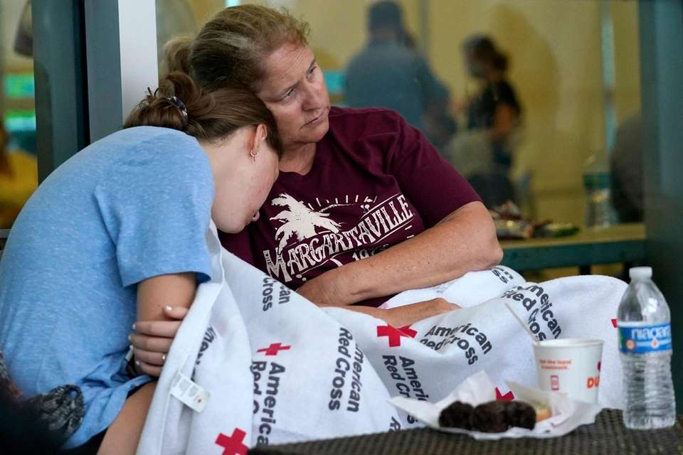 Jennifer Carr, right, sits with her daughter as