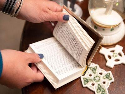 A Jewish prayer book alongside Celtic Christmas ornaments