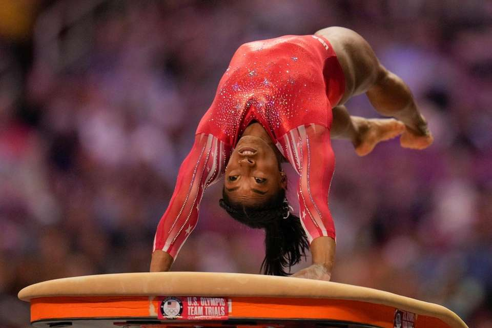 Simone Biles competes on the vault during the