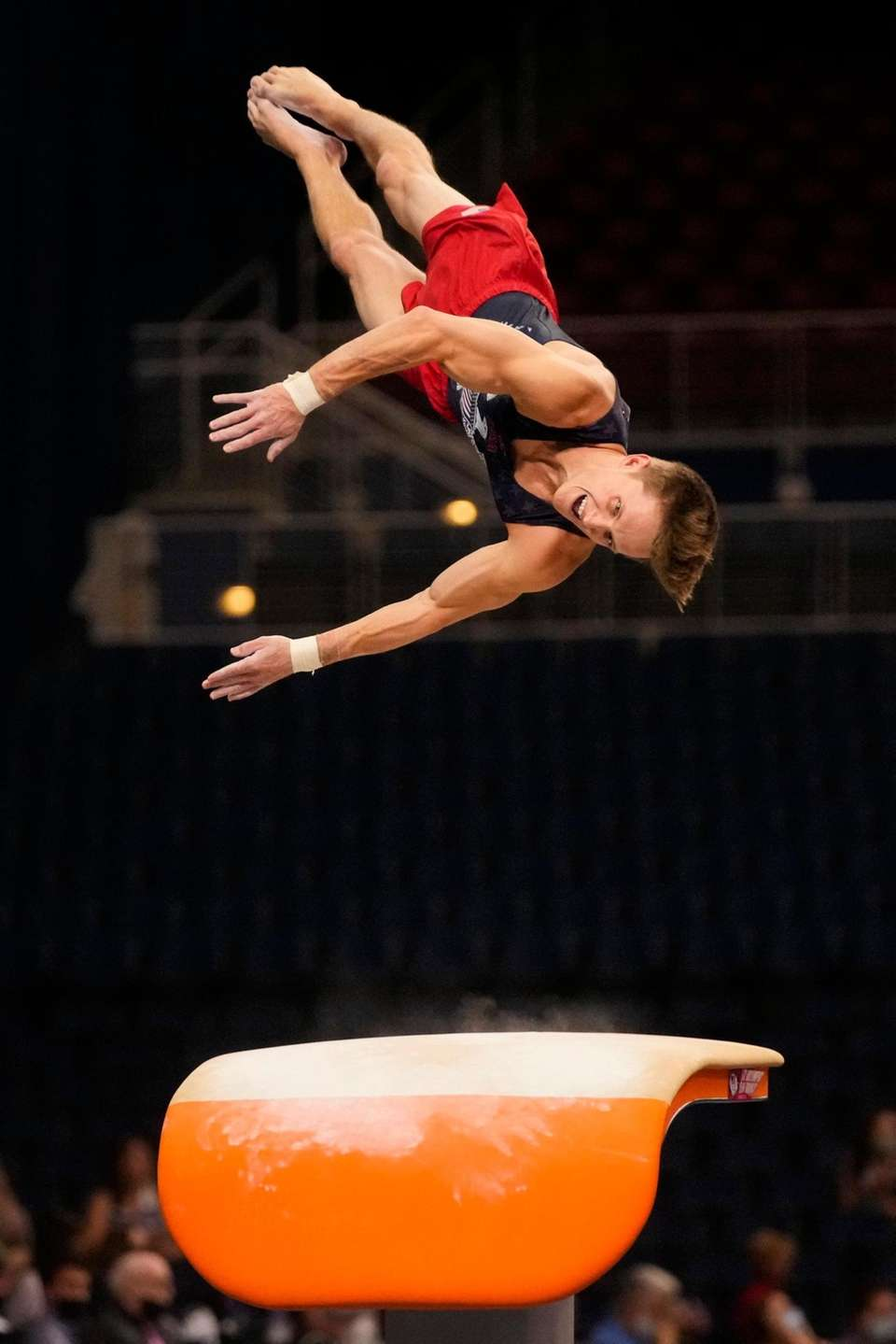 Allan Bower competes on the pommel horse during