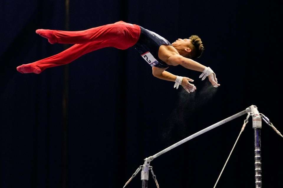 Yul Moldauer competes on the horizontal bar during