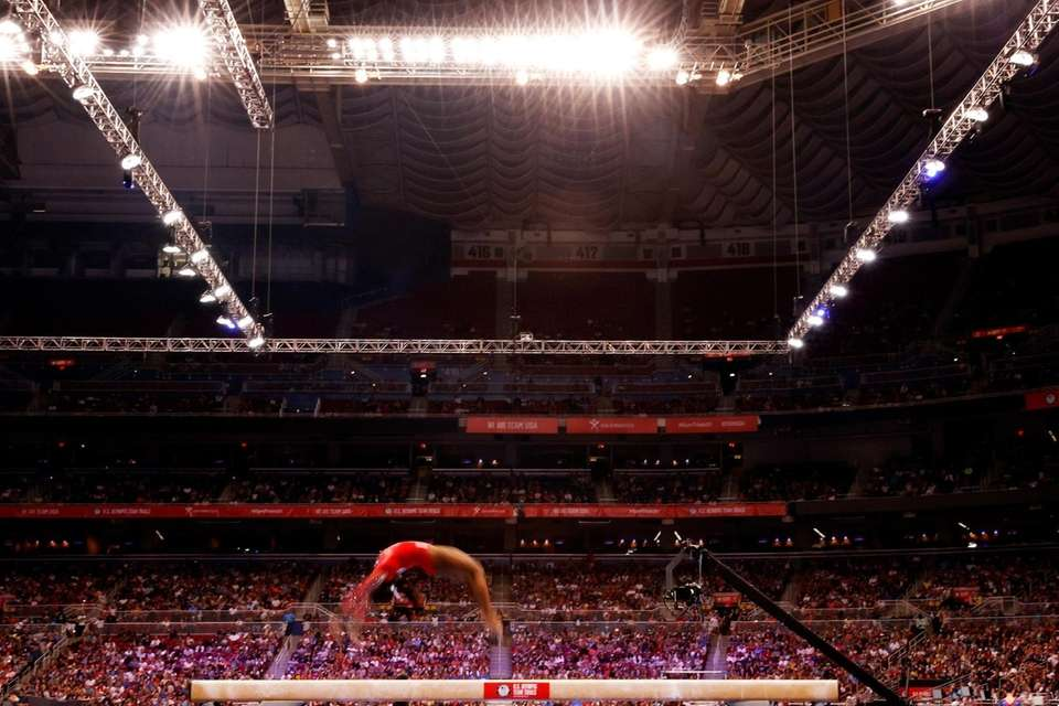 Simone Biles competes on the balance beam during