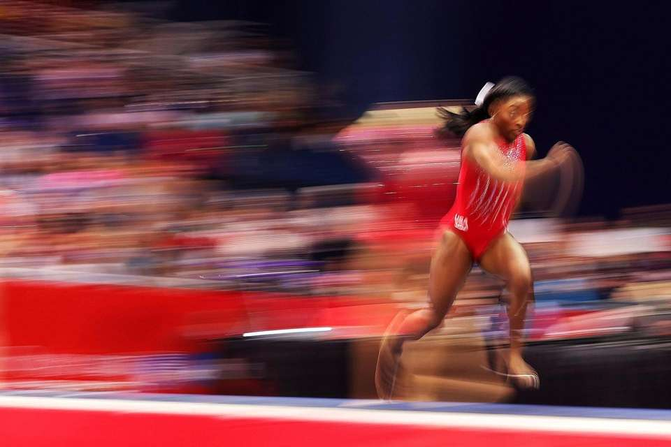 Simone Biles warms up on the vault prior