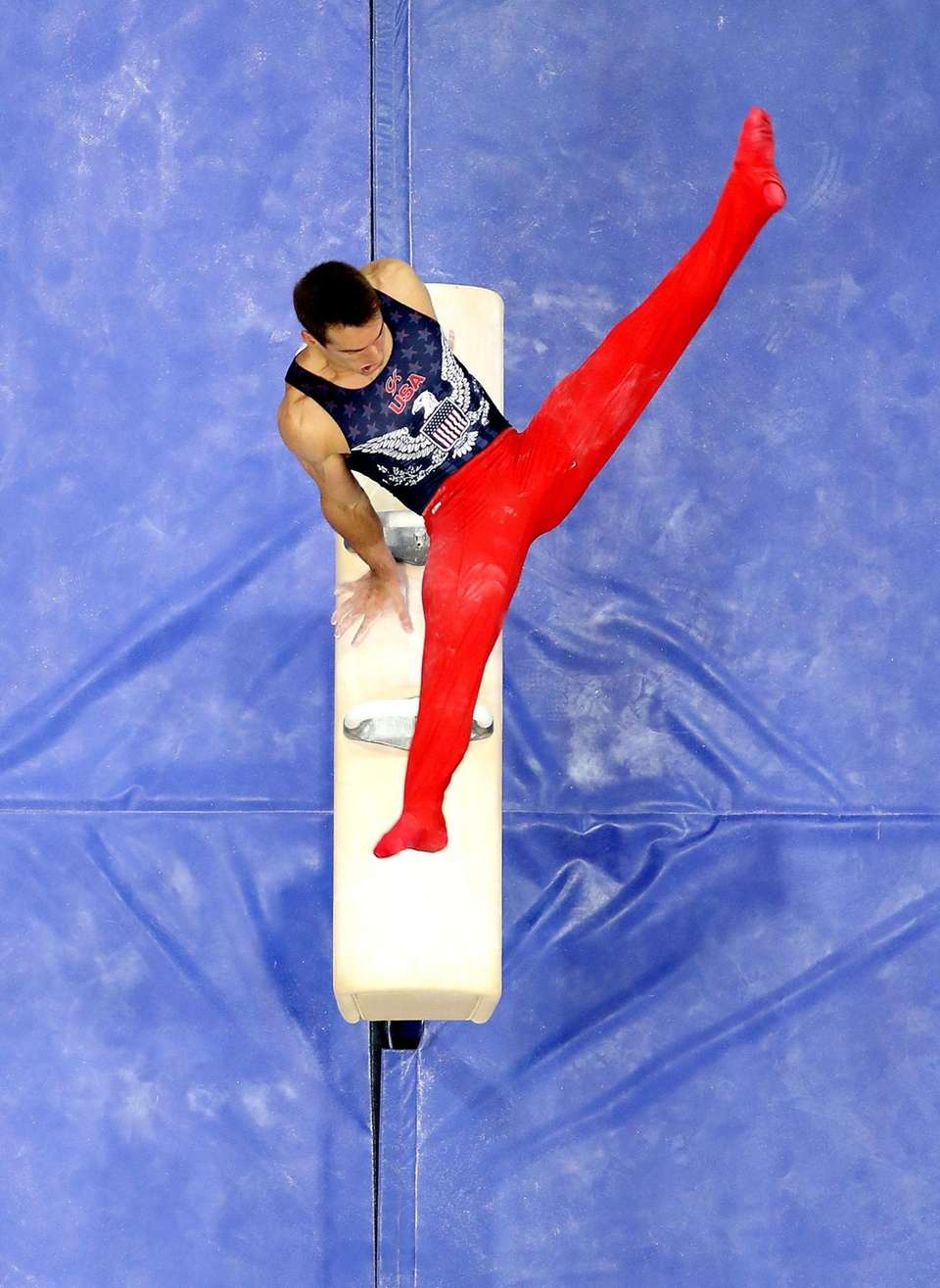 Mikulak competes on the pommel horse during the