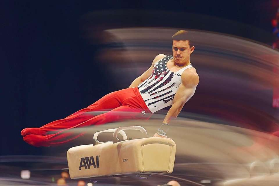 Brody Malone competes on pommel horse during the