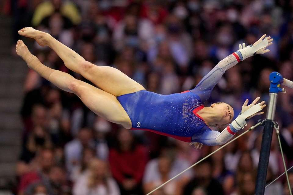 Riley McCusker competes on the uneven bars during