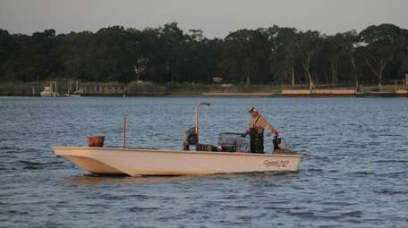 A bayman fishing in Moriches Bay on Monday,