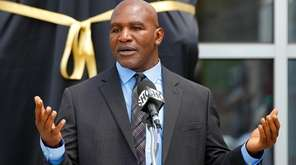 Evander Holyfield speaks at the podium during the