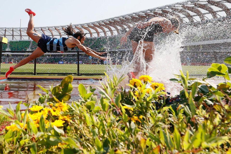 Jordan Mann falls into the water as he
