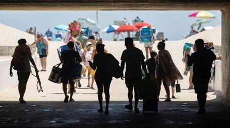 Beachgoers hit the sand at Gilgo Beach on