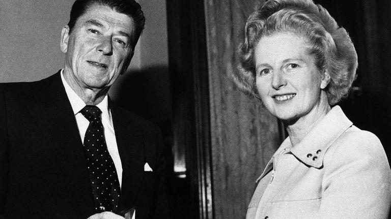 Ronald Reagan presents a silver dollar medallion to