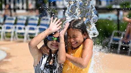 Cousins Nina Kacic, 8, of Queens, left, and