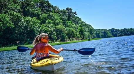 Kathryn Braunreuther Kayaks in the waters off of