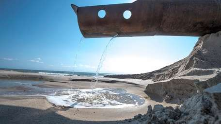Water running from a pipe after sand from