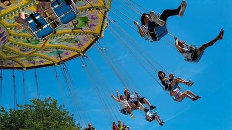People spin around on the Wave Swing ride