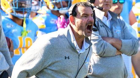 LIU Sharks coach Bryan Collins yells during a