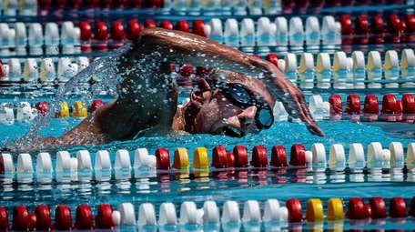 East Meadow resident Michael Pitzer swimming laps while