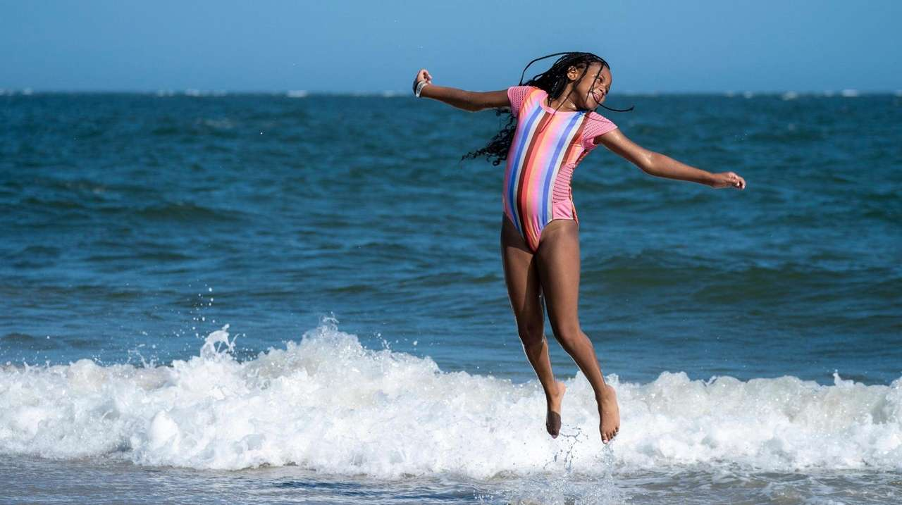 Saniah Lewis, 11, of Huntington, plays in the