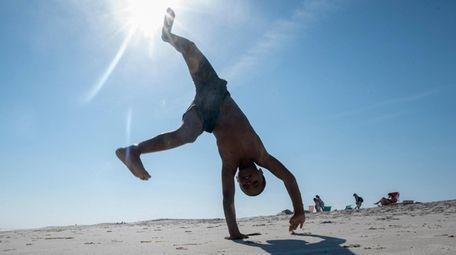Chris Welsh, 7, of Huntington, does cartwheels at