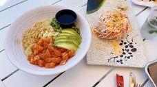 A sushi poke bowl and Miru Mountain at